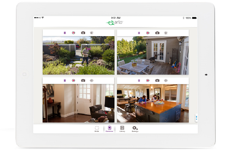 The Arlo secuirty app open on a tablet, showing the video feed from multiple Arlo Q cameras