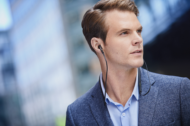 Close up of man wearing the Jabra Elite 25e headphones