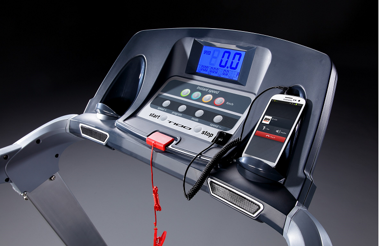 The T100 Treadmill' control console with safety switch and Smartphone connected.