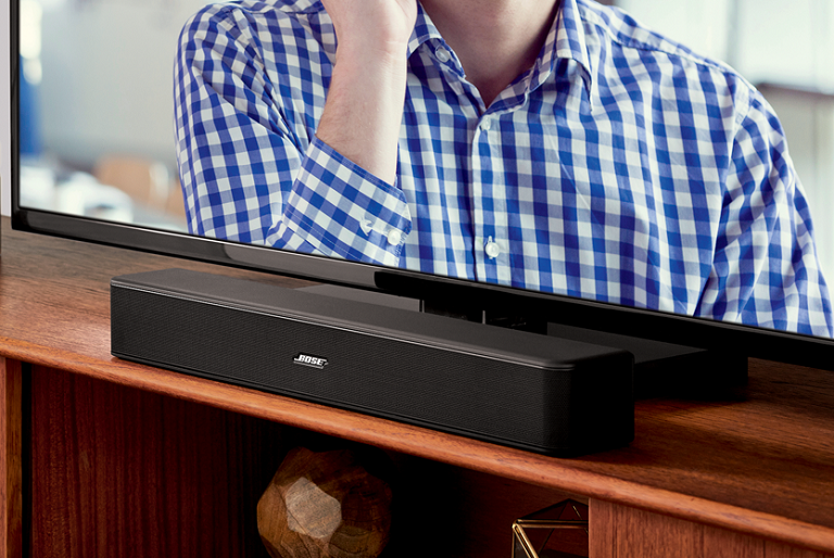 The Bose SOlo 5 on an entertainment unit under a TV