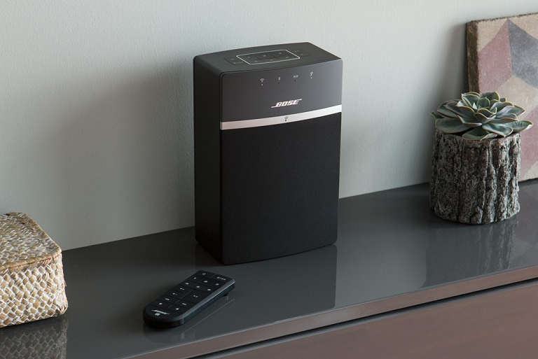 The Bose music system with remote on a sideboard