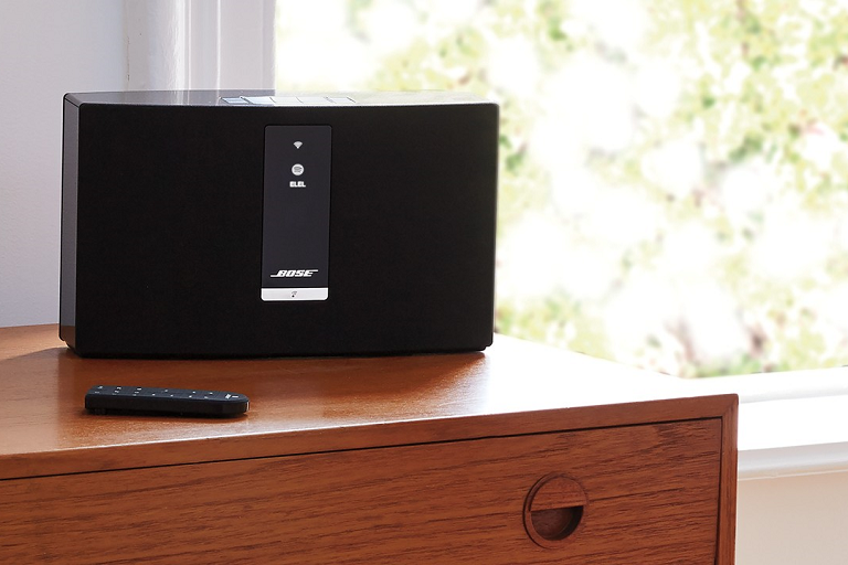 The Bose Wireless Music SYstem on a wooden table