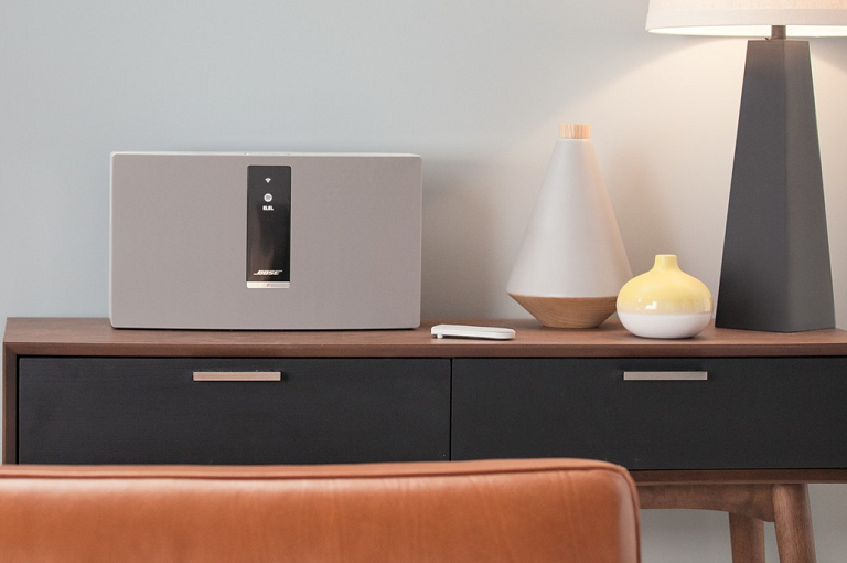 The Bose SoundTouch 30 on a sideboard with lamps