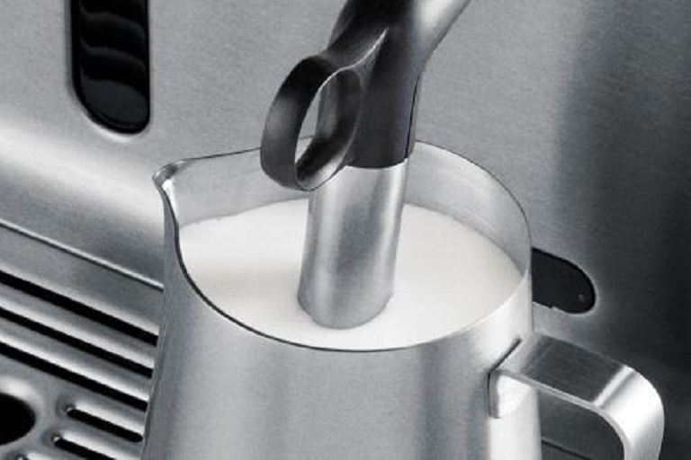 Frothing milk with The Oracle Espresso machine
