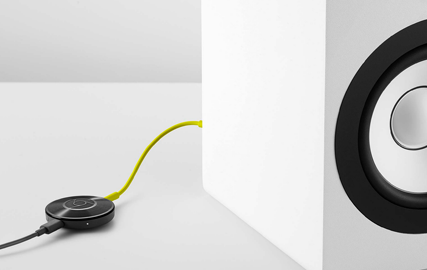 Chromecast Audio plugged in to  speaker.