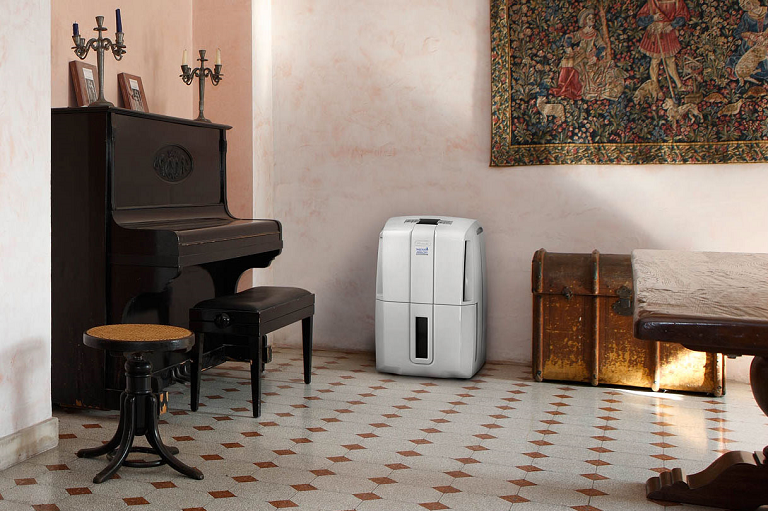 The AriaDry dehumidifier in a stylish living room