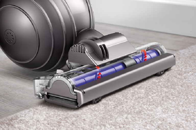 The Dyson DC65 vacuum cleaning hardfloors and caqrpet