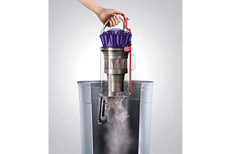 Emptying the Dyson upright vacuum's dust barrel