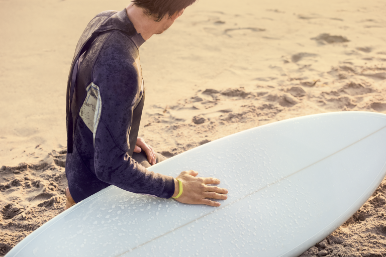 waxing a surfboard + fitness