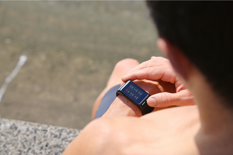 A man checks alets on his Garmin Smart Watch