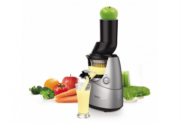 The Kuvings Slow Juicer surrounded by fruits and vegetables