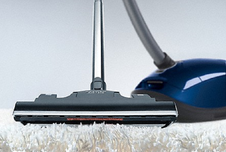 The Miele vacuum cleaning a thick rug