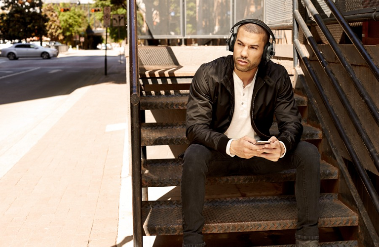 A man sitting on stairs outside 