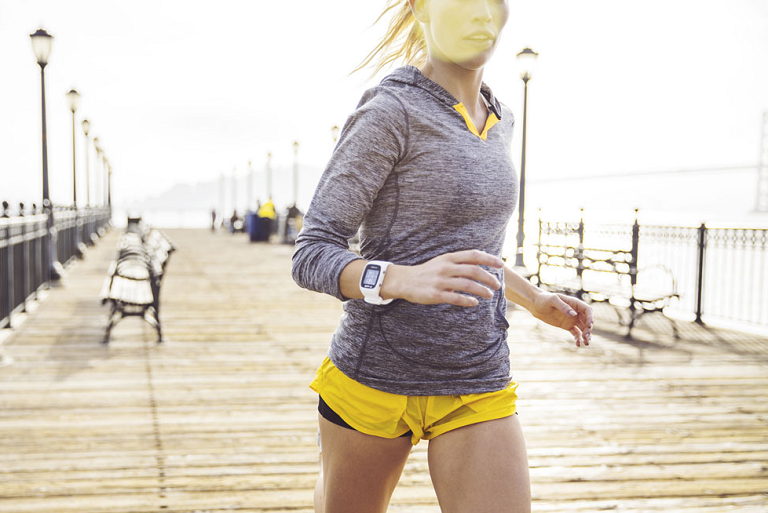 A woman running wearing the POlar M400 watch