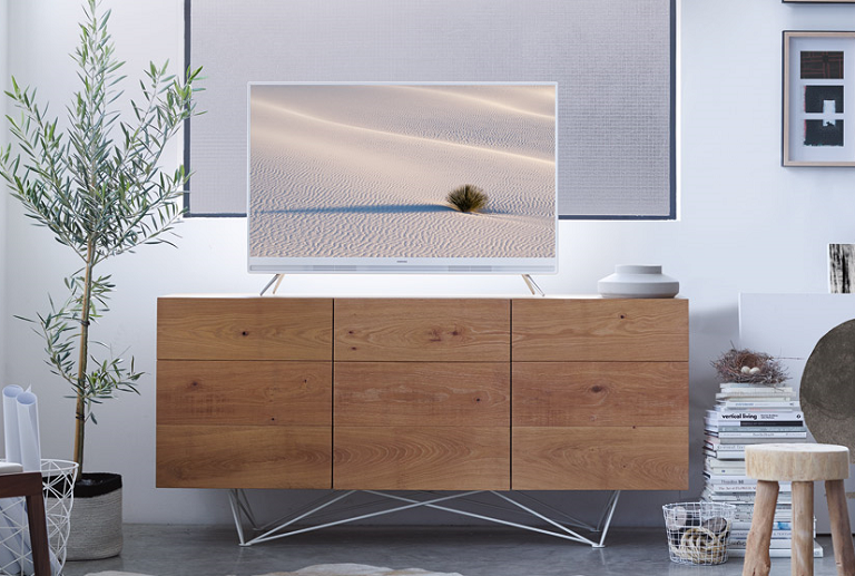 The Samsung Pure & White sits atop a TV unit in an elegant living room