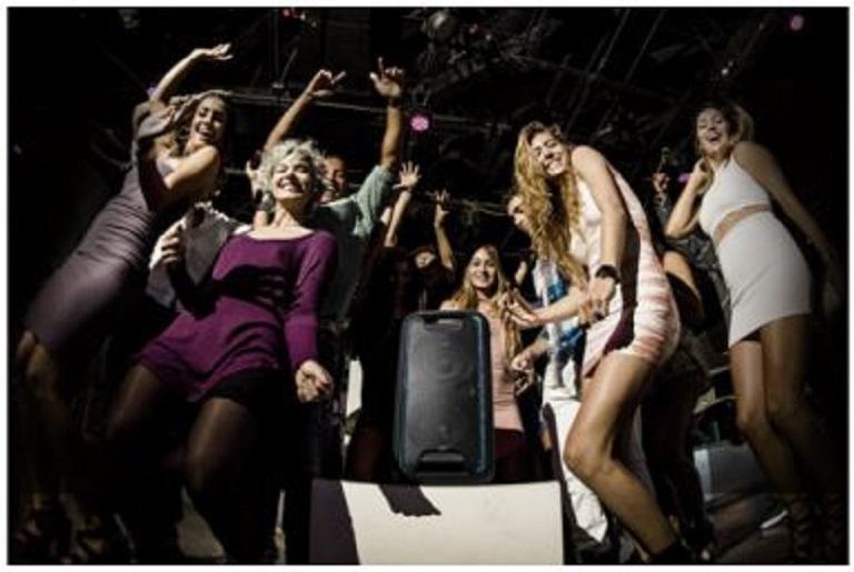 Friends dancing around the Sony GTK-XB5