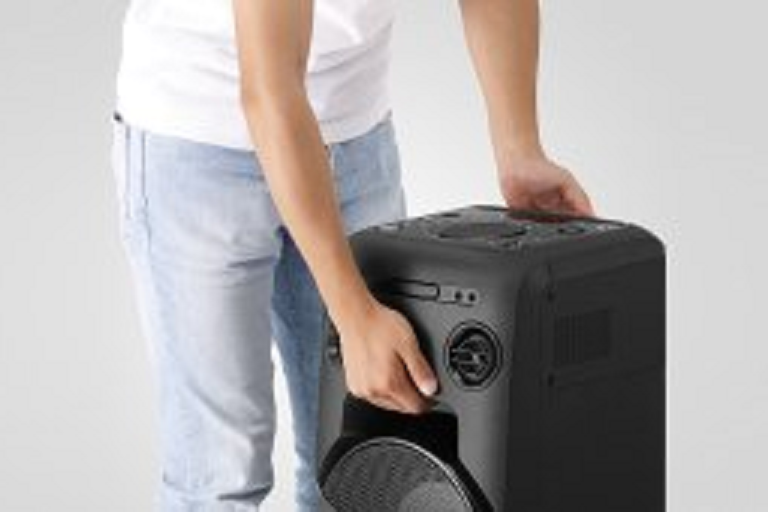 Man lifting the Sony hi fi system