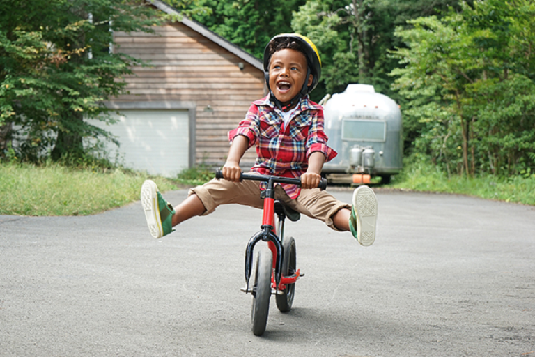 a young boy riding a bike
