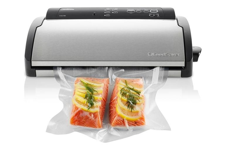 The Sunbeam Foodsaver sealing salmon fillets in a vacuum bag