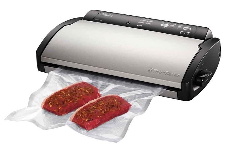 Steaks sealed in a vacuum bag by the Sunbeam Food Saver
