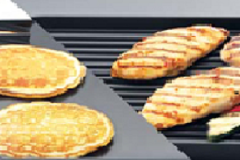 Cooking pancakes on the flat plate and grilling chicken on the ribber plate