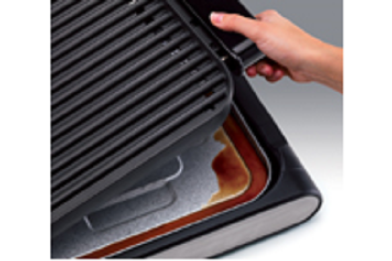 The Sunbeam grill's cooking plate clicks easily in and out for cooking and cleaning