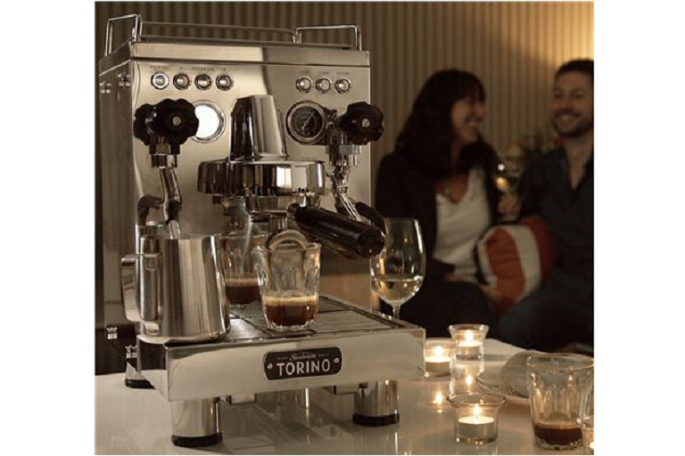 The Torino coffee machine in a romantic lounge setting