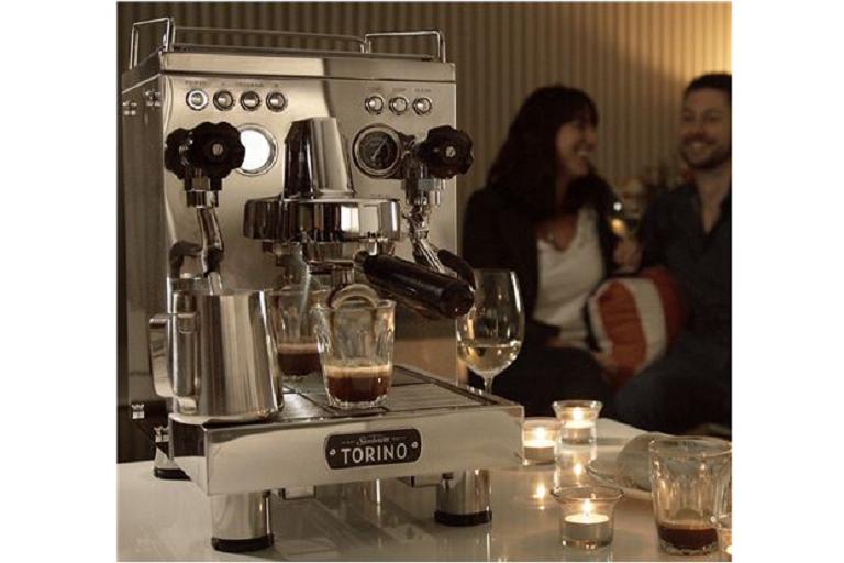The Torino coffee machine in a romantic lounge setting