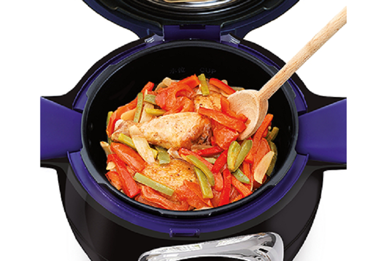The Tefal Cook4Me open, cooking a dish of chicken and vegetables