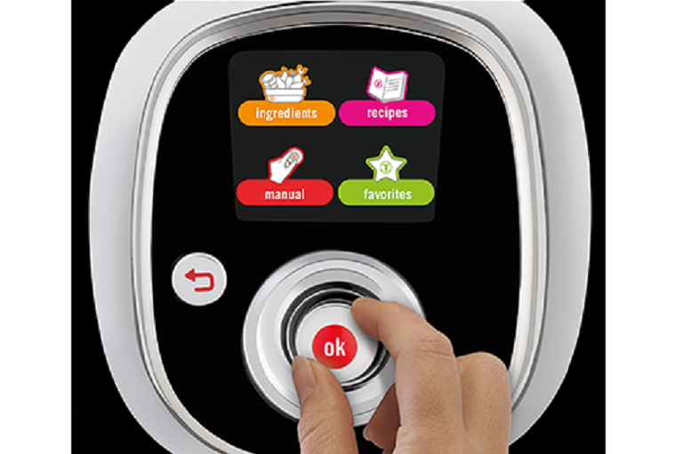 Close shot of a user selecting options on the multicooker's digital screen