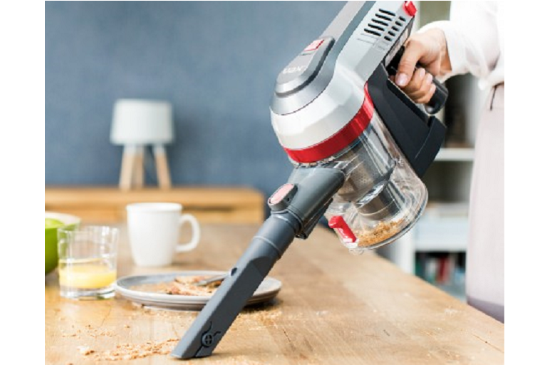 Cleaing a tabletop with the Vax Slim Stick Vacuum