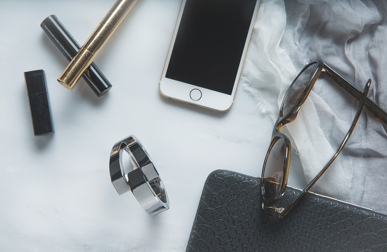 A Wisewear activity tracker beside 