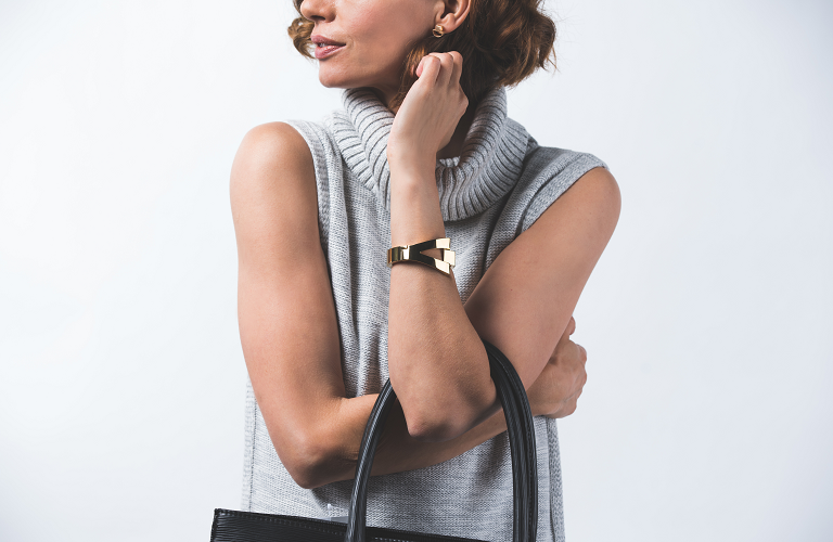 A woman with her arms croseed and 