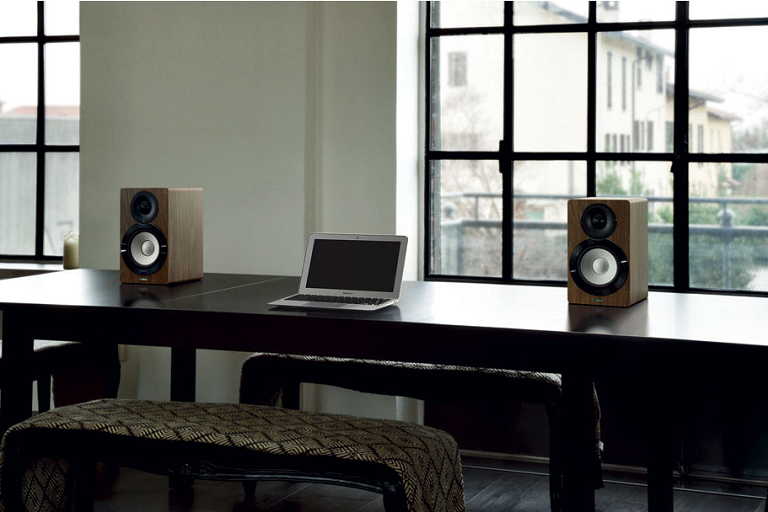 The MusicCast speakers beside a laptop