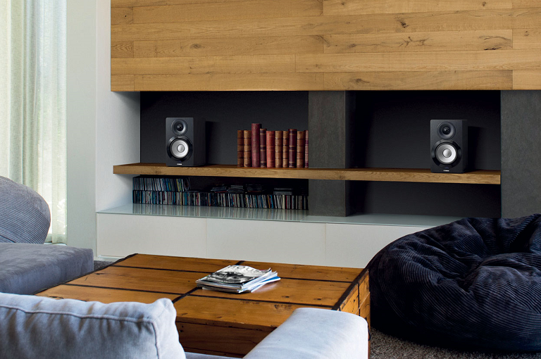 The Yamaha wireless speaker on a bookshelf in a living room